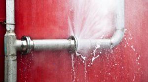 A burst pipe spraying water