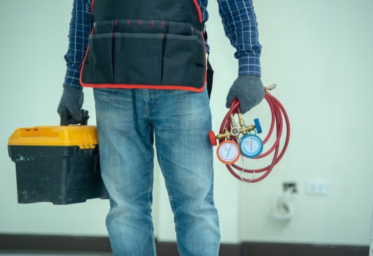 Plumber with a toolbox